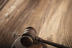 Law and justice theme. Mallet of judge. Wooden table Royalty Free Stock Photo