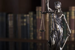 Law and justice theme. Statue of justice. Books in the court library Stock Photo
