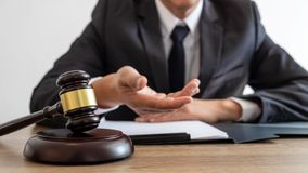 Free Law, Lawyer Attorney And Justice Concept, Male Lawyer Or Notary Working On A Documents And Report Of The Important Case In The Law Royalty Free Stock Images - 136453309