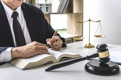 Law, lawyer attorney and justice concept, male lawyer or notary working on a documents and report of the important case in the. Workplace office stock images