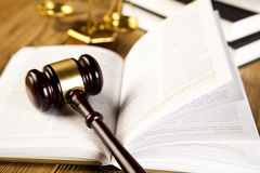 Law, legal code and scales of justice concept. Wooden gavel and books, ambient light vivid theme Stock Photo