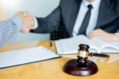 Law and Legal concept, Consultation between attorneys and clients customer shaking hands discussing contract agreement In. Courtroom royalty free stock image