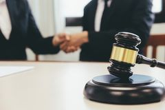 Law and Legal services concept. Lawyer and attorney having team meeting at law firm. Lawyer and businessman handshake royalty free stock photography