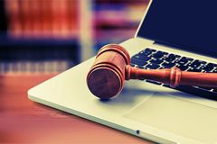 Law. Legal System Computer Internet Gavel Computer Crime Laptop stock photo