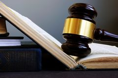 Law and legal system. Gavel and open book. stock photo