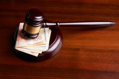 Law mallet or auctioneer`s hammer and money stack. Judges gavel, law mallet or auctioneer`s hammer and money stack on wooden table background, Corruption and Stock Photography