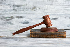 Law mallet on wooden surface. Stock Photography