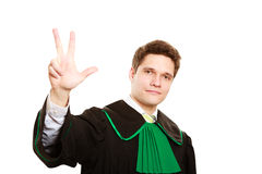 Law. Man lawyer in polish gown counting on fingers Stock Image