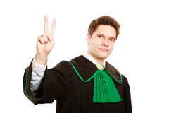 Law. Man lawyer in polish gown counting on fingers Royalty Free Stock Photo