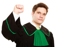 Law. Man lawyer in polish gown counting on fingers Stock Photography