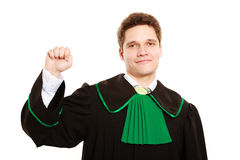 Law. Man lawyer in polish gown counting on fingers Royalty Free Stock Images