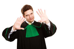 Law. Man lawyer in polish gown showing stop hand sign Royalty Free Stock Image