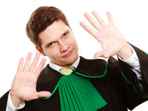 Law. Man lawyer in polish gown showing stop hand sign Stock Photography