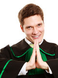 Law. Man lawyer in polish gown showing thanks gesture Royalty Free Stock Photo