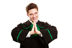 Law. Man lawyer in polish gown showing thanks gesture Royalty Free Stock Photos