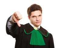 Law. Man lawyer in polish gown showing thumb down Royalty Free Stock Images