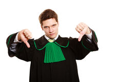 Law. Man lawyer in polish gown showing thumb down Stock Photography