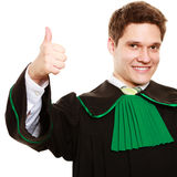 Law. Man lawyer in polish gown showing thumb up Royalty Free Stock Photography