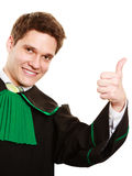 Law. Man lawyer in polish gown showing thumb up Royalty Free Stock Photo
