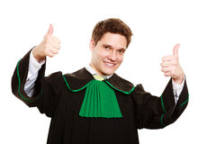 Law. Man lawyer in polish gown showing thumb up Stock Photo