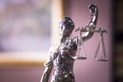 Law office legal statue. Legal office of lawyers and attorneys legal bronze model statue of Themis goddess of justice royalty free stock photos