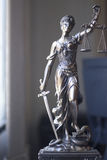 Law office legal statue Themis. Law offices of lawyers legal statue Greek blind goddess Themis bronze metal statuette figurine with scales of justice stock photo
