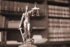 Law offices legal statue Themis. Law offices of lawyers legal statue Greek blind goddess Themis bronze metal statuette figurine with scales of justice Royalty Free Stock Photography