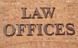 Law Offices Sign. On Brick Wall Stock Photo