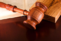 Law and Order. Gavel and law book on a table judge Stock Photography