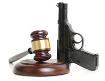 Law and order. A gun with a gavel isolated on white Royalty Free Stock Photo