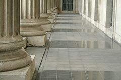 Law and Order Pillars Outside Court. Law and order pillars outside a courthouse stock images