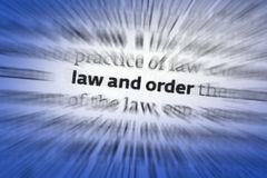 Law and Order. The Law - the system of rules that a particular country or community recognizes as regulating the actions of its members that may be enforced by Royalty Free Stock Images