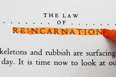 The law of Reincarnation. In an old book highlighted stock photo