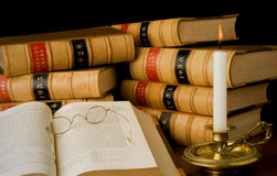 Law reports. Old law reports, vintage glasses and candle Royalty Free Stock Photos