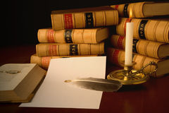 Law Reports. Old law reports, glasses, candle and quill Royalty Free Stock Image