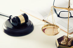 Law scale justice with gavel in background Stock Photos