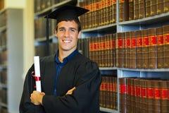 Law school graduate. Handsome university law school graduate in library Stock Photos