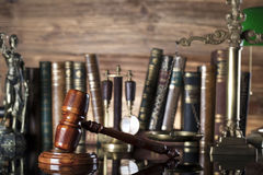 Law symbols. Legal system. Law and justice concept. Gavel and books on the wooden background royalty free stock images