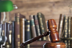 Law symbols. Legal system. Law and justice concept. Gavel and books on the wooden background stock image