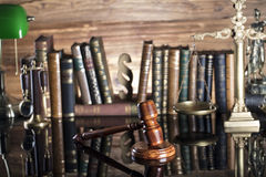 Law symbols. Legal system. Law and justice concept. Gavel and books on the wooden background stock images