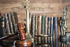 Law symbols. Legal system. Law and justice concept. Gavel and books on the wooden background stock photos