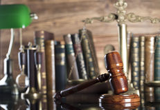 Law symbols. Legal system. Law and justice concept. Gavel and books on the wooden background royalty free stock photography