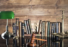 Law symbols. Legal system. Law and justice concept. Gavel and books on the wooden background stock photo