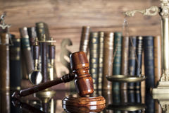Law symbols. Legal system. Law and justice concept. Gavel and books on the wooden background royalty free stock photos