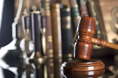 Law symbols. Legal system. Law and justice concept. Gavel and books on the wooden background royalty free stock image