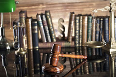 Law symbols. Legal system. Law and justice concept. Gavel and books on the wooden background stock photography
