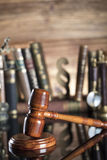 Law symbols. Legal system. Law and justice concept. Gavel and books on the wooden background royalty free stock photo