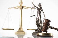 Law theme. Law symbols  on white background. Gavel, scale and Themis Stock Photo