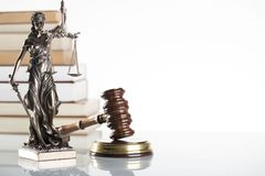 Law theme. Law symbols  on white background. Gavel and Themis Stock Image