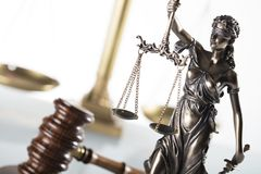 Law theme. Law symbols  on white background. Gavel and Themis Stock Photo